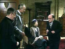 Father Brown (Kenneth More) and Hercule Flambeau (Dennis Burgess) greet Miss Ammerley (Rosamund Greenwood) and  Thurston (Dudley Jones).