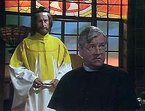 Kalon (Ronald Pickup) and Father Brown (Kenneth More), in Kalon's temple.