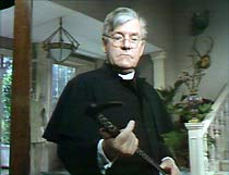 Father Brown (Kenneth More) weighs up the evidence: a heavy walking stick.