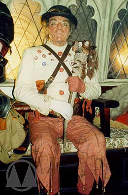 Terrific costume work for the Tooley (Arthur Whybrow). Note the Underground map trousers, the Tube roundel badges, the ticket collector's straps across his chest, and the adapted Action Men dolls incorporated into his rattle.