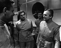 Foreground - Blaine (Charles Tingwell) and Dr Cole (Robert Macleod)