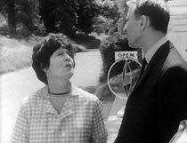 Frank (Alfred Burke) questions Mrs Flockton (Anna Wing).