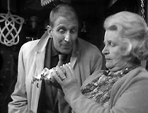 Frank (Alfred Burke) haggles with the Antique Shop Lady (Susan Richards)