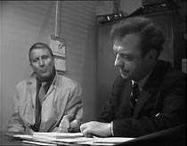 Frank (Alfred Burke) checks in with his probation officer, Jim Hull (John Grieve)