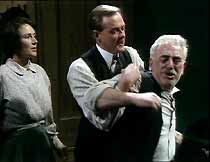 Jessie (Susan Jameson) watches as Jack (James Bolam) restrains Bill (James Garbutt) from attacking Tom.