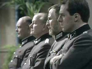 Occupying forces: Oberleutnant Otto Kluge (John Malcolm), Major Ernst Freidel (Simon Lack), Major-Doktor Dieter Richter (Alfred Burke) and Hauptmann Reineke (Simon Cadell).